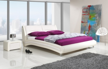Nadčasová čalúnená manželská posteľ Laurent